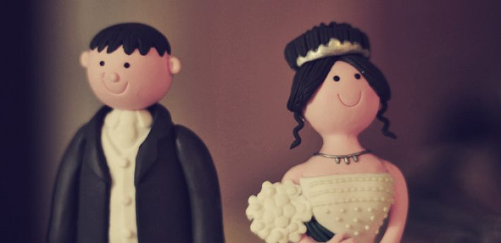 Bride & groom wedding cake figurines photo by bigpresh via a Creative Commons License on Flickr.